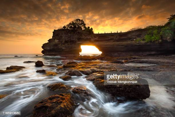 sunset of batu bolong temple - bali indonesia - tanah lot stock pictures, royalty-free photos & images