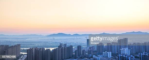 sunset of Fuzhou city, old town area bird view under dramatic sky