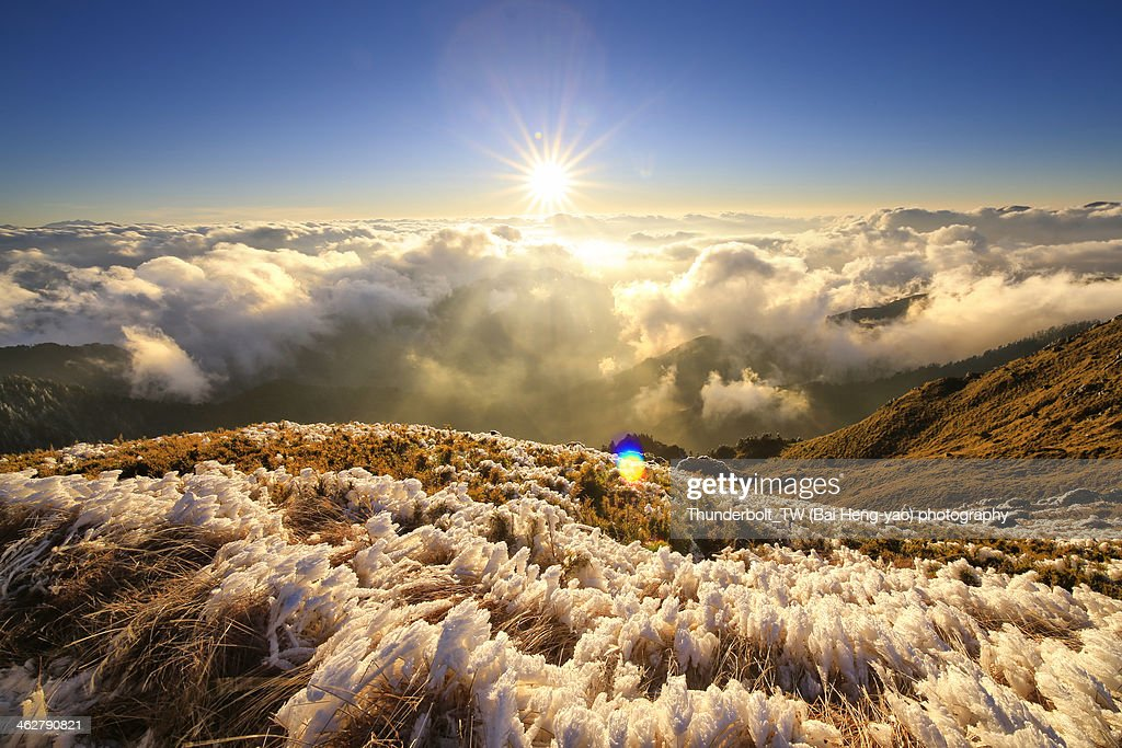 sunset of high mountain in snowy winter day : Stock Photo