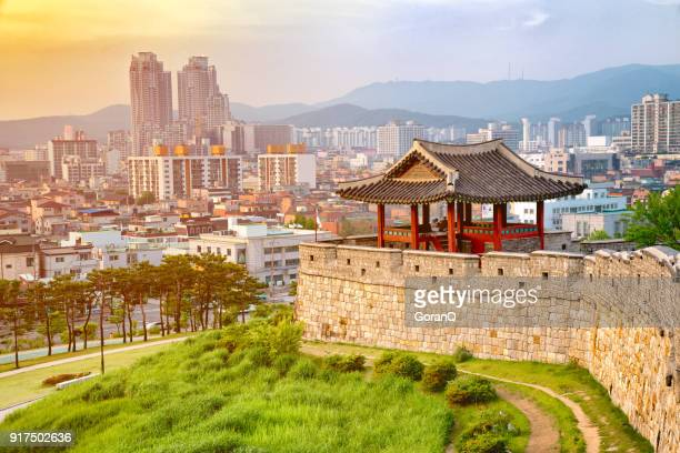 sunset of hwaseong  fortress is a joseon dynasty that surrounds the centre of suwon city,south korea. - south korea stock pictures, royalty-free photos & images