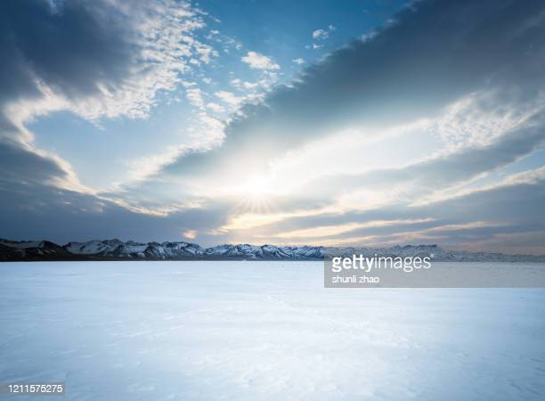 sunset of snow mountain on plateau - extreme terrain stock pictures, royalty-free photos & images