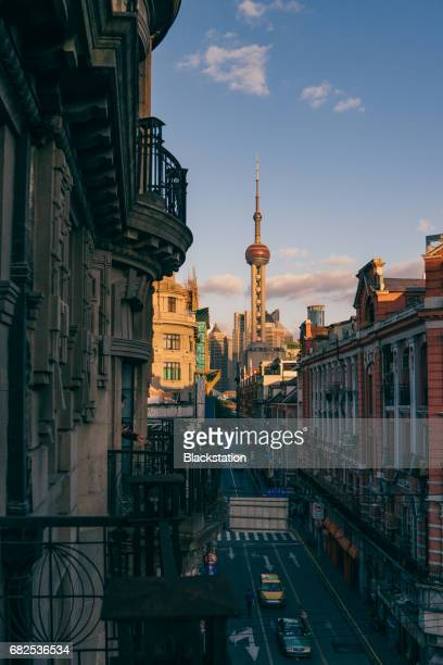 sunset of the blocks - oriental pearl tower shanghai stock pictures, royalty-free photos & images