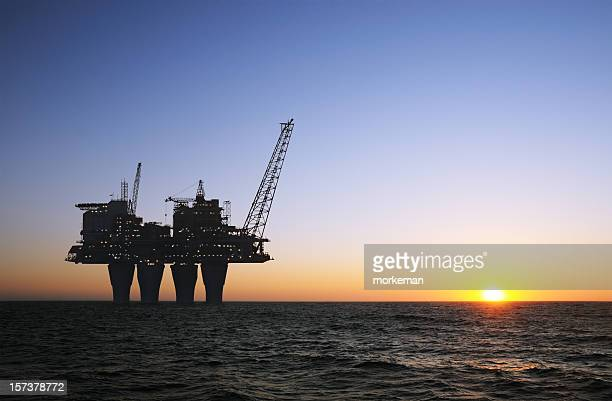 sunset offshore platform - north sea stock pictures, royalty-free photos & images