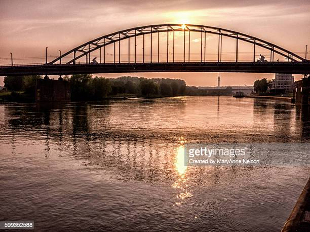 sunset on a bridge - deventer stock photos and pictures