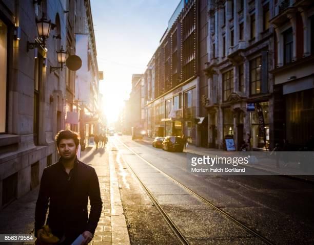 sunset on a city street - オスロ ストックフォトと画像