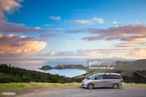 a sunset on a coromandel beach. - 陸の乗り物 ストックフォトと画像