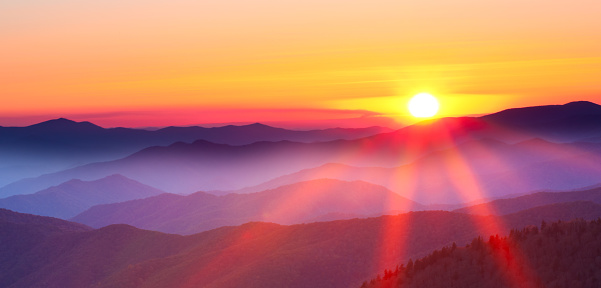 Sunset on a foggy mountain range 154890195