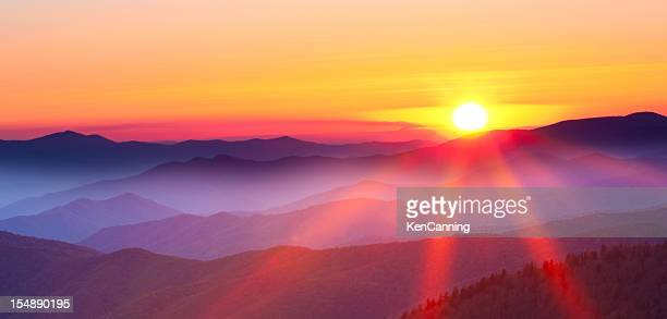 sunset on a foggy mountain range - hill stock pictures, royalty-free photos & images