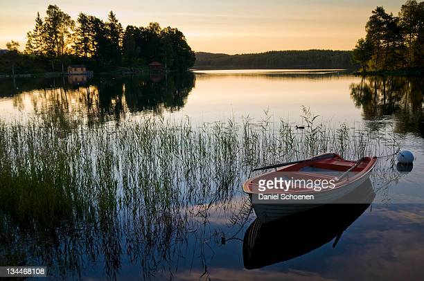 Sunset on a lake near Bengtsfors, Sweden, Europe