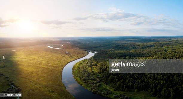 sunset on a river - russia stock pictures, royalty-free photos & images