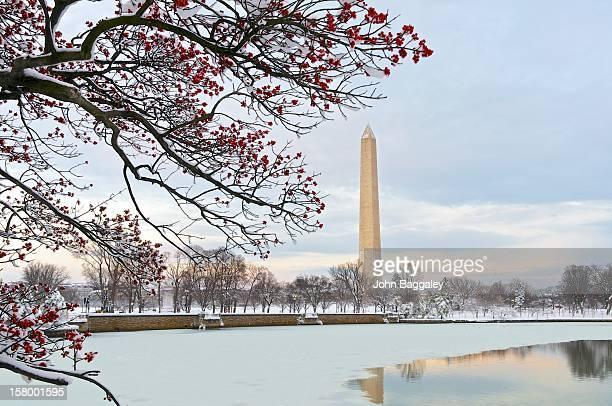 sunset on a snowy washington monument - washington monument washington dc stock pictures, royalty-free photos & images