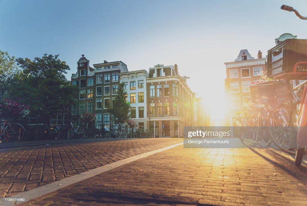 Sunset on a street in Amsterdam : Stockfoto