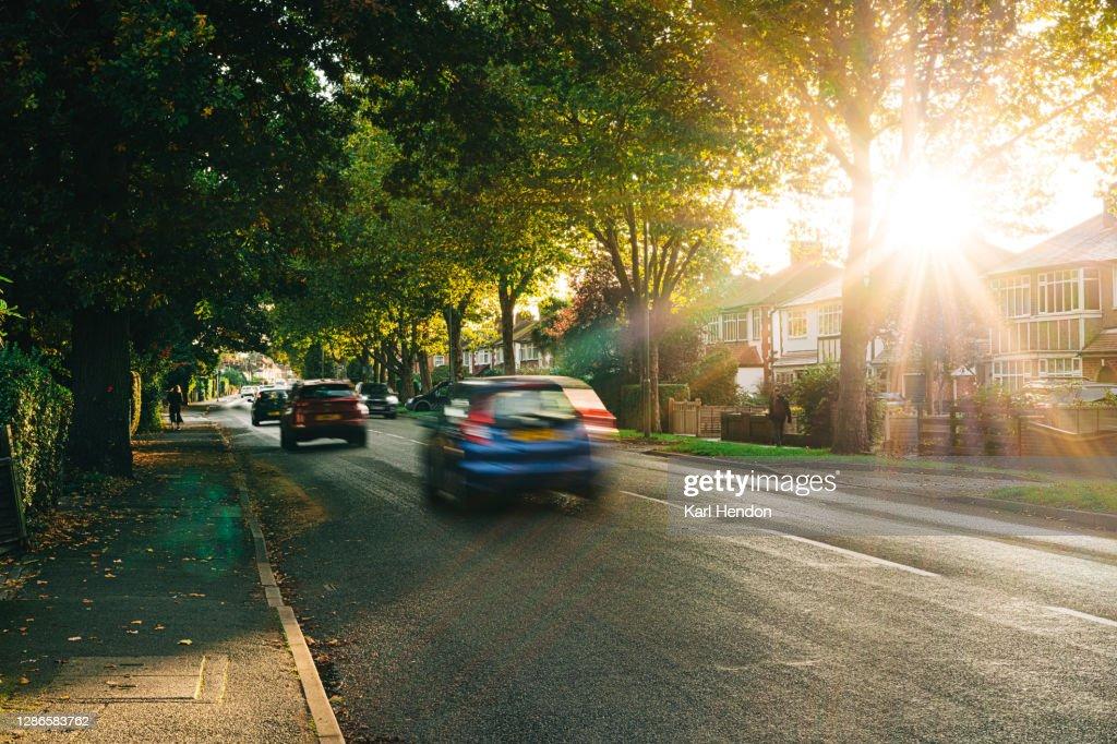 Sunset on a surburban street in Surrey, UK : Stock Photo