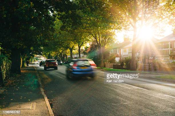 sunset on a surburban street in surrey, uk - car stock pictures, royalty-free photos & images