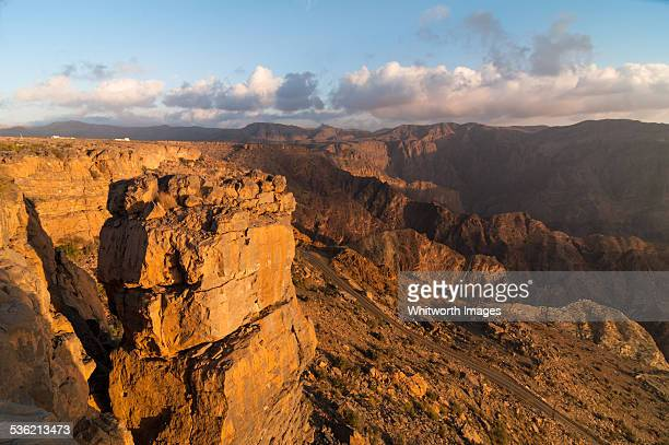 Sunset on arid mountains in Oman