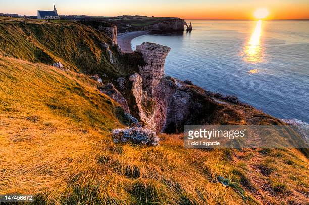 sunset on etretat cliff. - lagarde stock photos and pictures