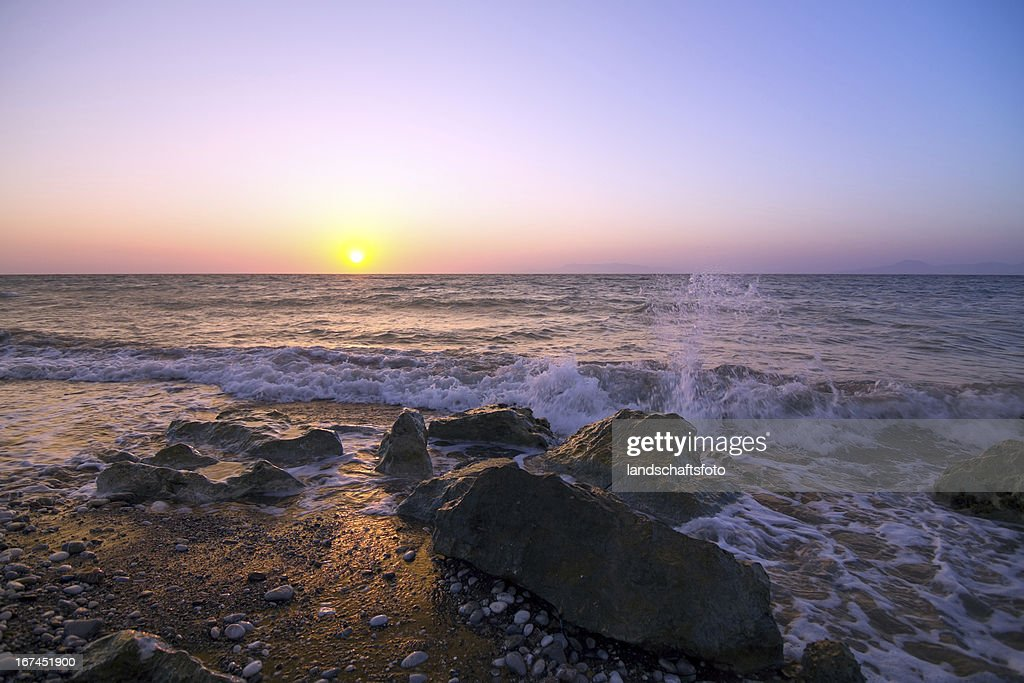 sunset on greek coast : Stock Photo