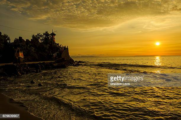 sunset on iconic hindu temple on lombok - by sheldon levis stock pictures, royalty-free photos & images