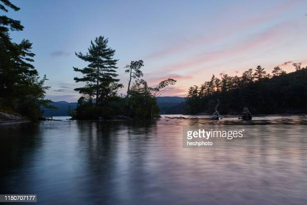 sunset on island - heshphoto stock pictures, royalty-free photos & images
