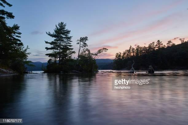 sunset on island - heshphoto stock-fotos und bilder