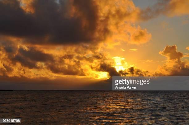 sunset on kailua beach - kailua beach stock photos and pictures