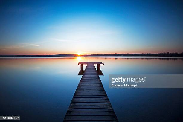 Sunset on lake Ammer with pier