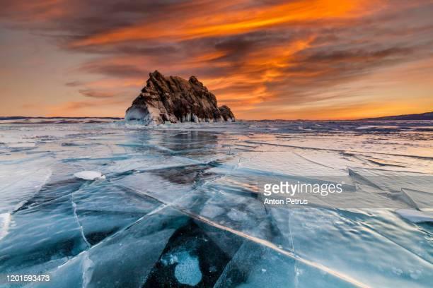 sunset on lake baikal in winter near elenka island - シベリア ストックフォトと画像