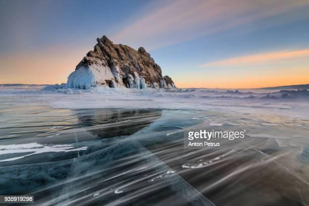 Sunset on Lake Baikal in winter near Elenka island