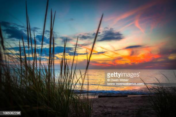 sunset on lake michigan - lake michigan stock pictures, royalty-free photos & images