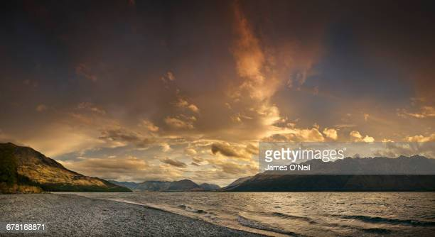 sunset on lake wakatipu near queenstown