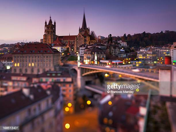 sunset on lausanne cathedral and old town - lausanne stock photos and pictures
