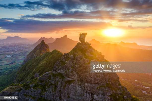 sunset on le pouce mountain and indian ocean, aerial view, mauritius - indian ocean stock pictures, royalty-free photos & images
