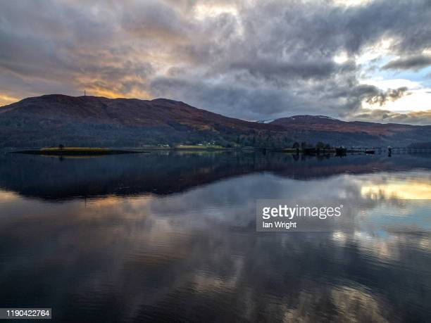 sunset on loch linnhe - moment of silence stock pictures, royalty-free photos & images