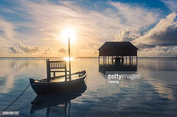Sunset on Maldives island, romantic honeymoon water villas resort and love boat, Maldives island