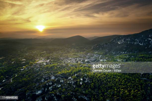 sunset on mourèze - herault stock pictures, royalty-free photos & images