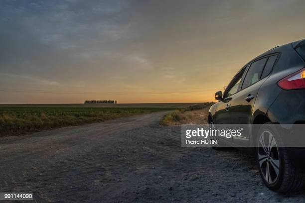 sunset on my car - roadside stock pictures, royalty-free photos & images