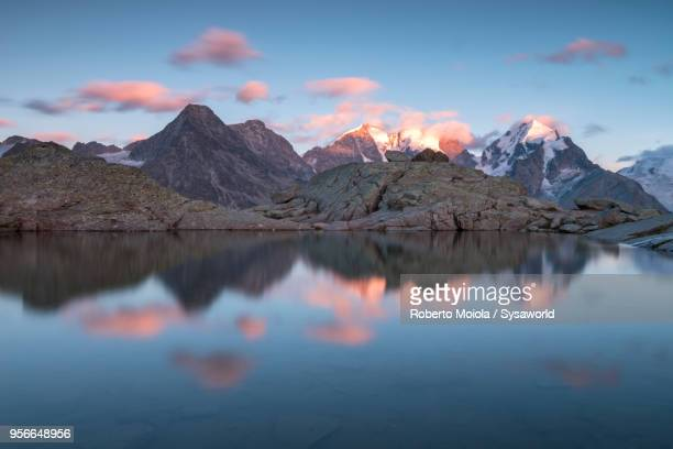 sunset on piz bernina, switzerland - mirror lake stock pictures, royalty-free photos & images