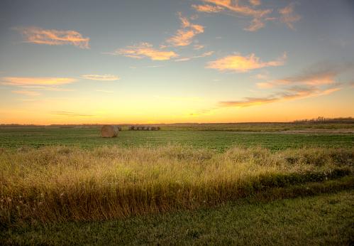 sunset on prairie field 873754720