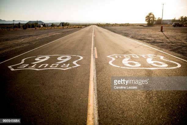 sunset on road 66. arizona. - route 66 stock-fotos und bilder