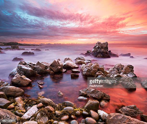 sunset on rocky western australian coastline - western australia stock photos and pictures