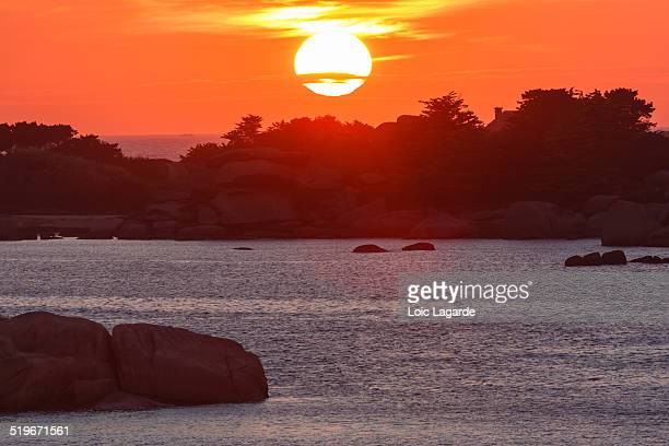 sunset on saint guirec beach - lagarde stock photos and pictures