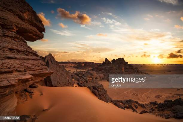 sunset on tadrart acacus - libya stock pictures, royalty-free photos & images