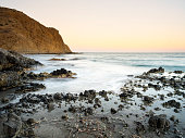 Sunset on the beach and rocky coast of the Cabo de Gata with formations of volcanic rock.  Cabo de Gata - Nijar Natural Park, Cala Monsul, Beach, Biosphere Reserve, Almeria,  Andalusia, Spain