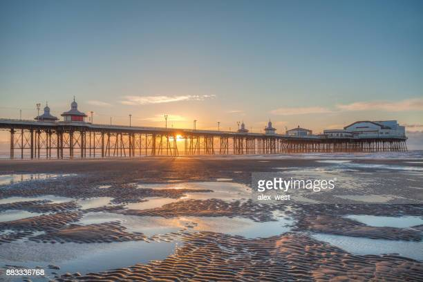 sunset on the beach. - blackpool stock photos and pictures