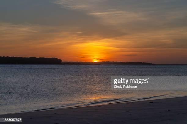 sunset on the coast - 南東 ストックフォトと画像