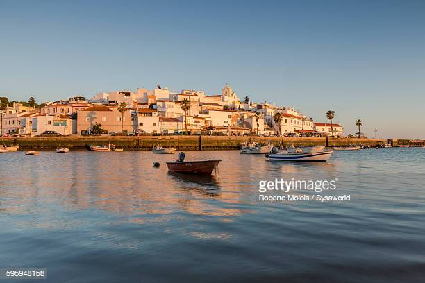 sunset on the fishing village ferragudo portugal - algarve stock photos and pictures