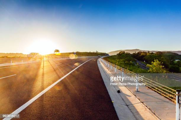 sunset on the highway - new south wales stock pictures, royalty-free photos & images