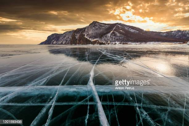 sunset on the ice of lake baikal - arctic stock pictures, royalty-free photos & images