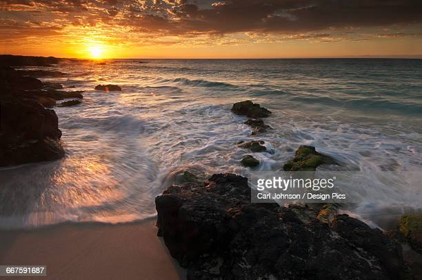 sunset on the kona-kailoa coast - kona coast stock photos and pictures