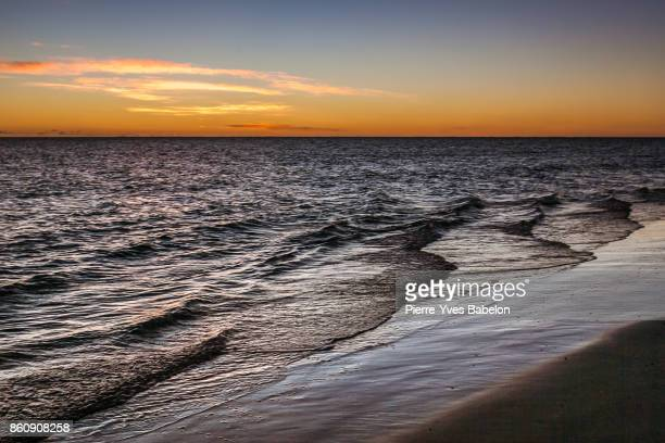 sunset on the lagoon - pierre yves babelon stock pictures, royalty-free photos & images